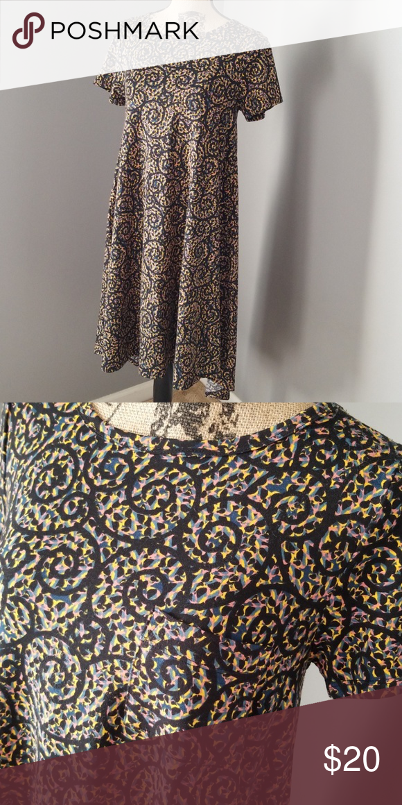72c3023aa2b1 🎁Cute Lularoe Carty Very pretty black swirl pattern Carly, high low.  LuLaRoe Dresses