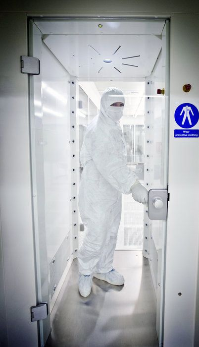 Laboratory Room Design: A Gowned Technician Passes Through An Air Shower To Blast