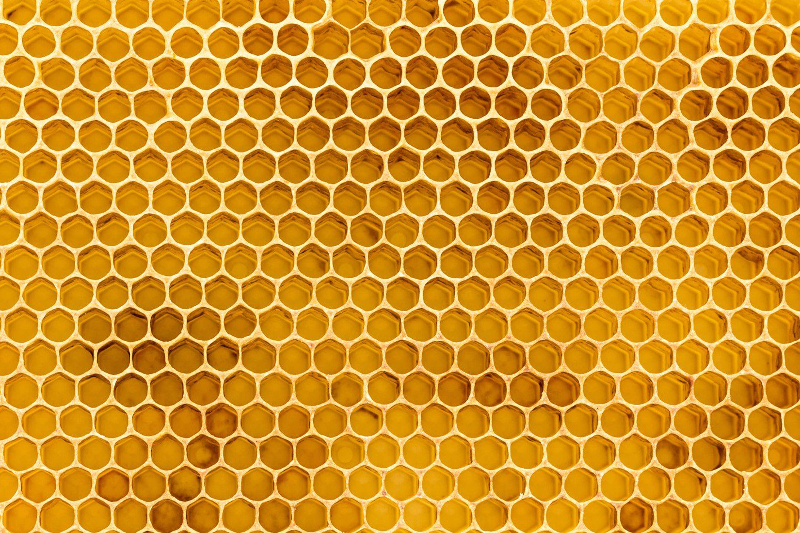 With Its Warm Colors And Simple Arrangement Our Honeycomb Texture Wallpaper Mural Is Both Interesting And Versat Honeycomb Wallpaper Honeycomb Mural Wallpaper