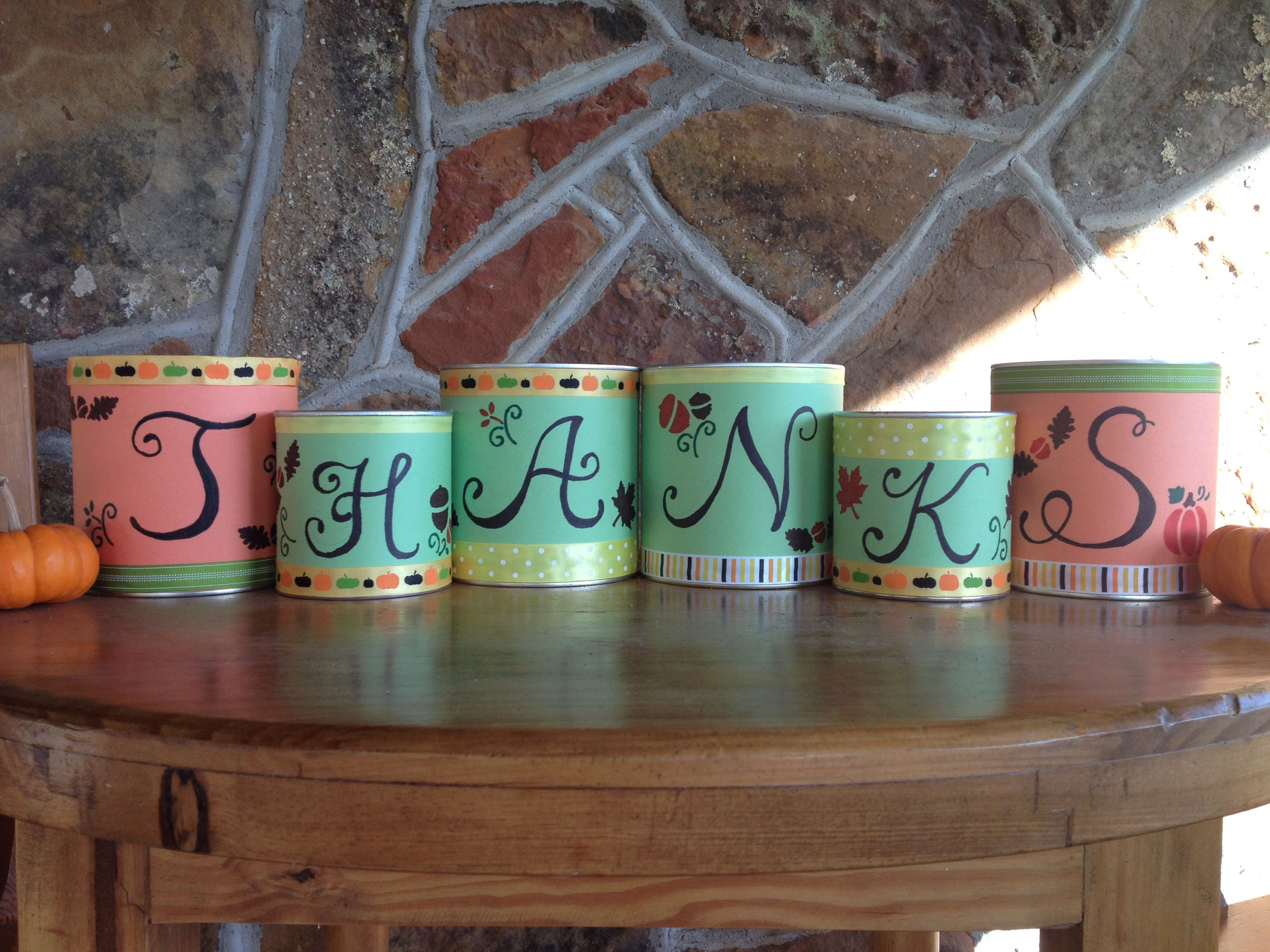 Thanksgiving decor made from empty formula cans and construction