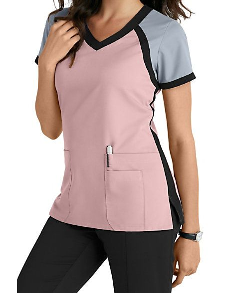 8289e0e4c3e This athletically-inspired scrub top from the popular Grey's Anatomy brand  gives you a fresh look for the season! A color block crossover v-neck  design ...