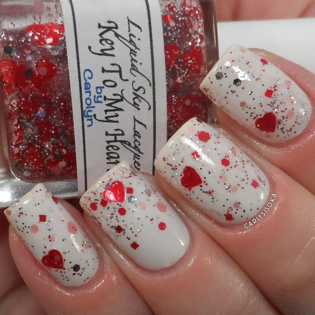 Liquid Sky Lacquer- Key to My Heart is full of pink, red, silver, and holographic glitter in all different shapes and sizes! Shown is 2 thin coats over Essie- Marshmallow with the hearts hand placed. You can get this baby today at 2pm PST, link to shop in @whimsicalcolor's bio! - @Carly Sisoka- #webstagram