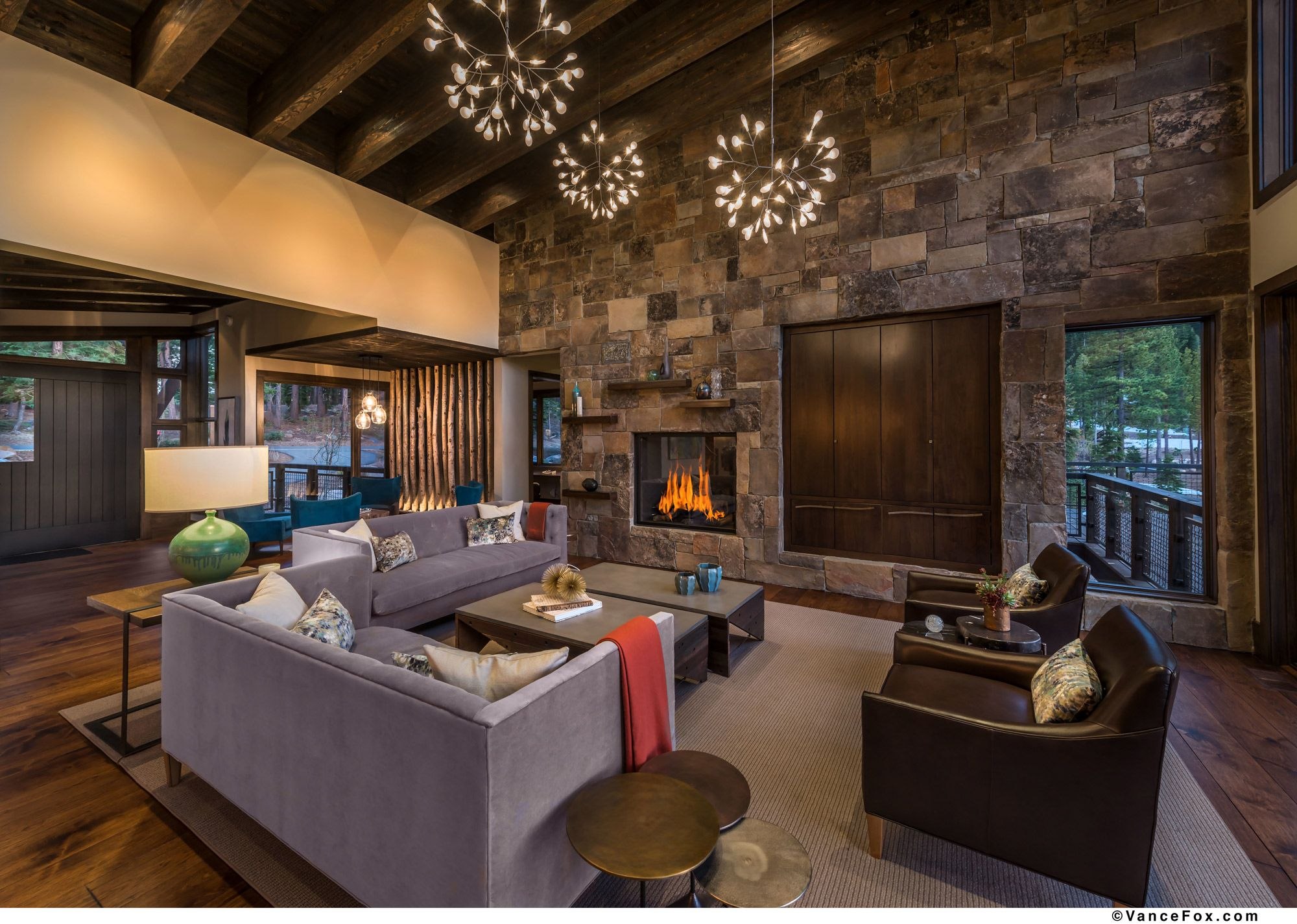 mountainliving greatroom rockfireplace Heslin Construction Custom Home