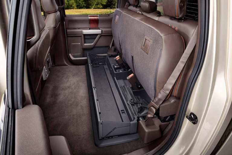 The Ford Super Duty has a lockable under-seat storage box in Crew Cab rear seat | Ford Super ...