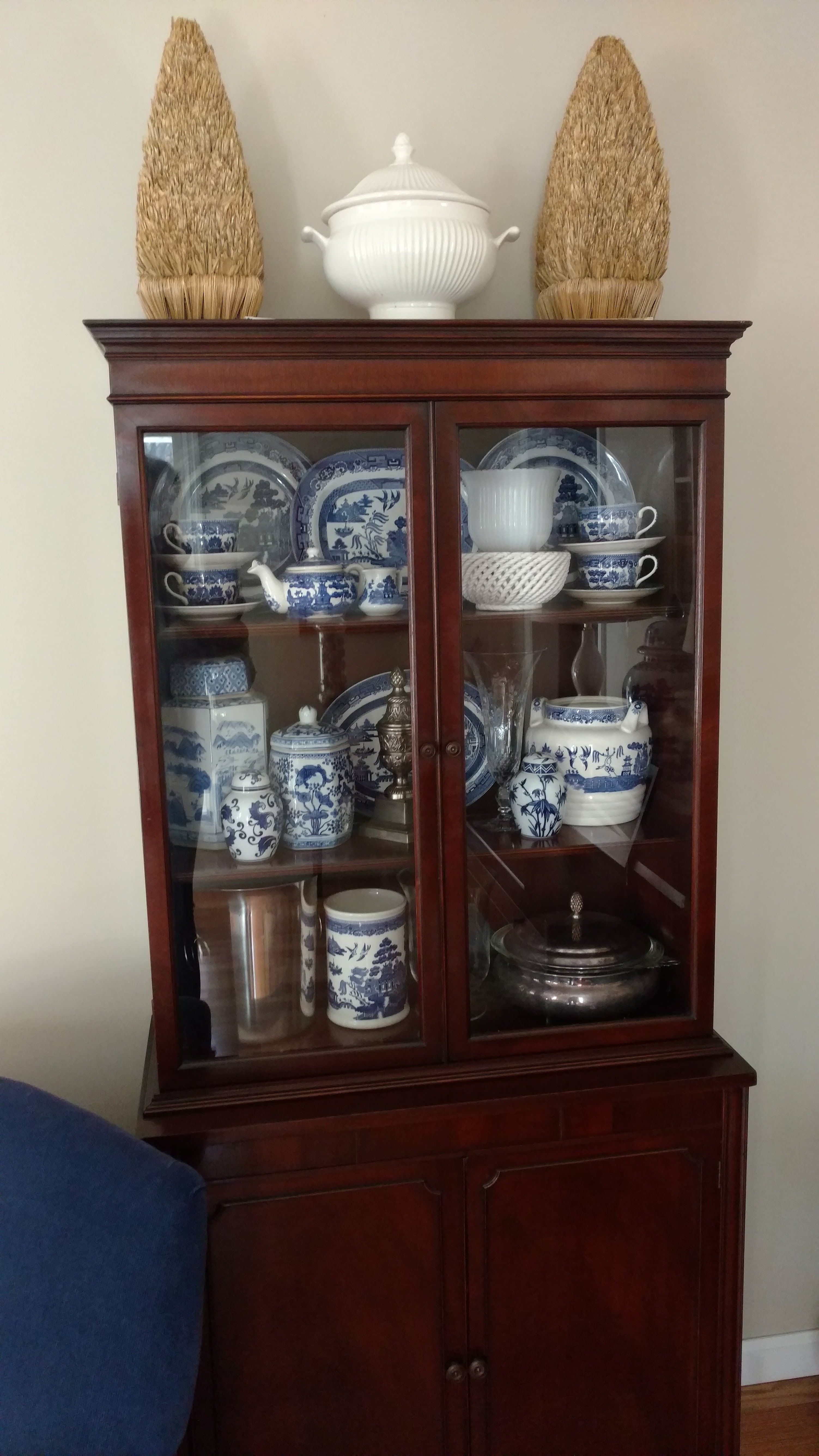 Fill a china cabinet with blue and white collected china. Big impact, big style!   #coastallifestyledesign #CLDtipoftheday