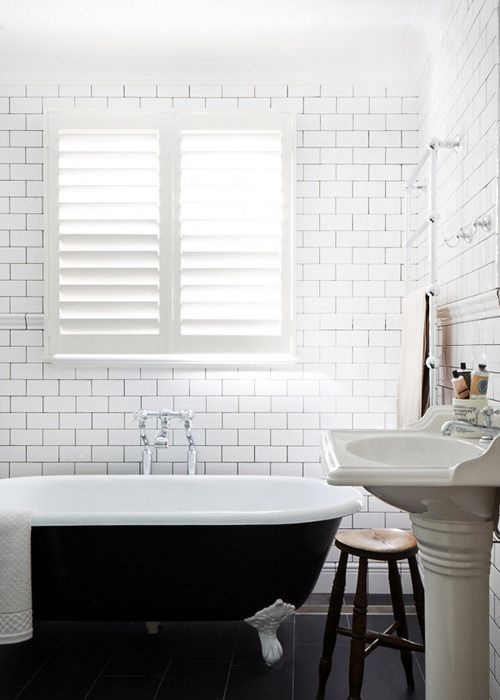 Clawfoot Tub Painted Black With Lots Of White Subway Tile With