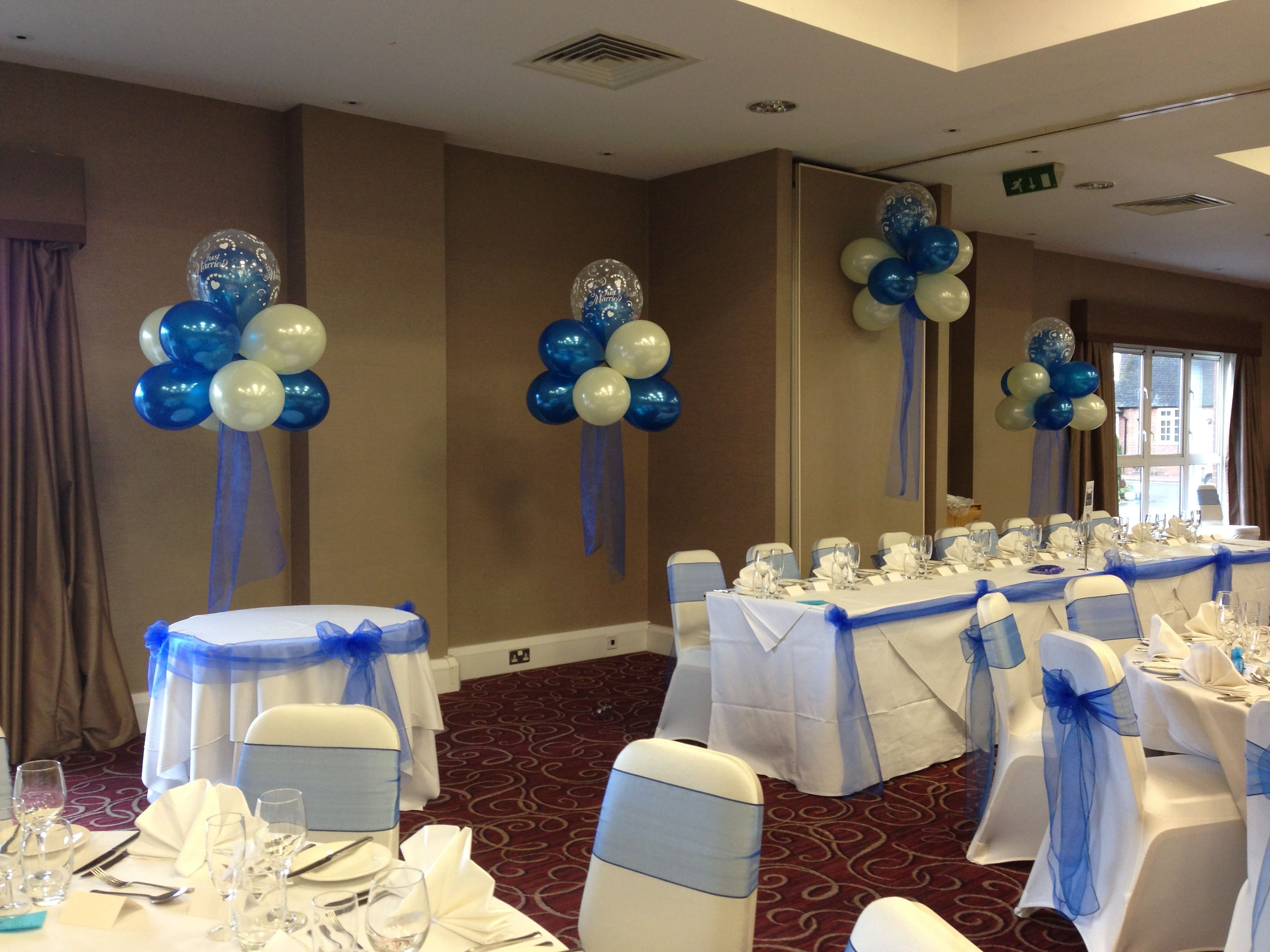 Wedding cloud balloon displays with chair covers in Ivory and