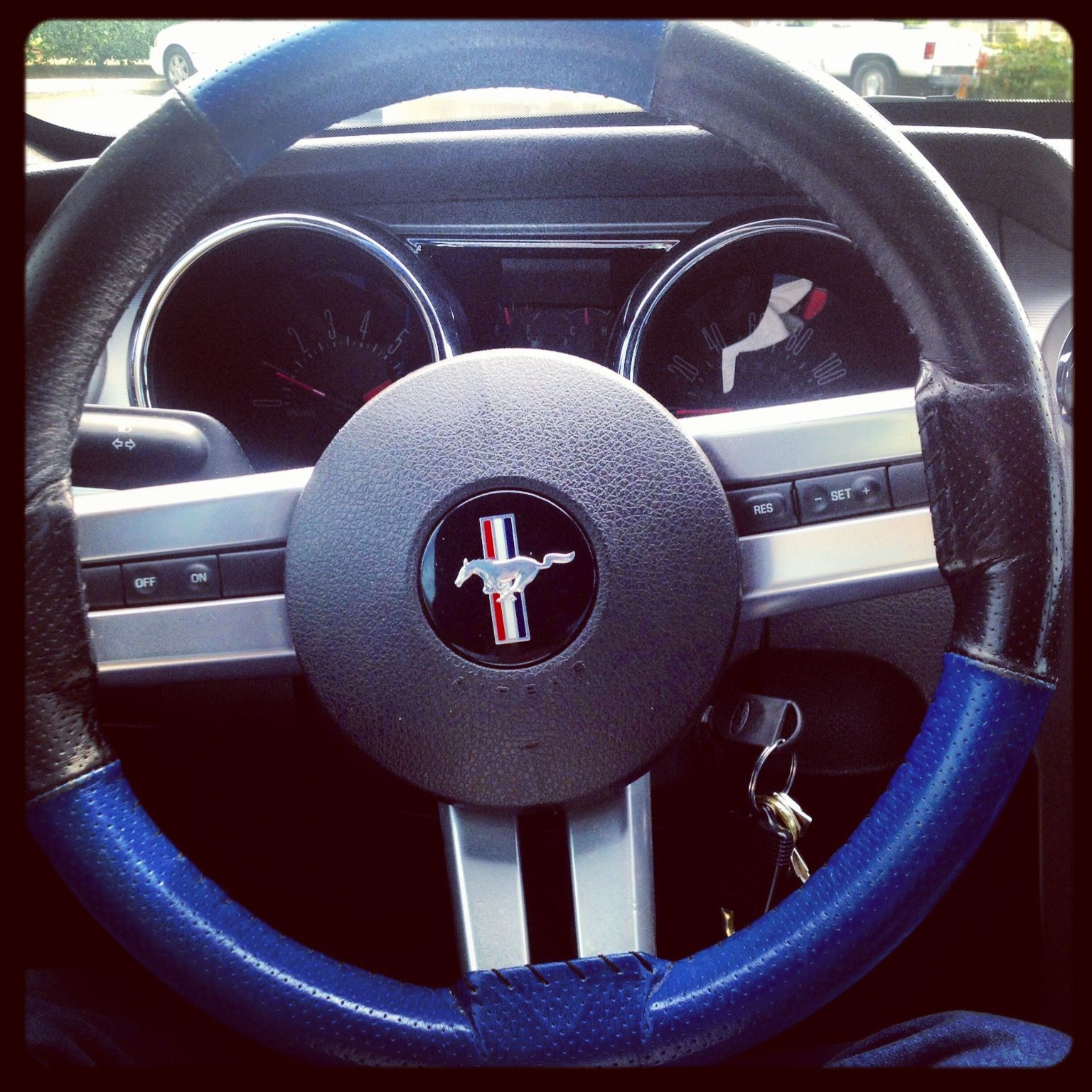 Steering wheel wrap, black and blue leather, love this ...