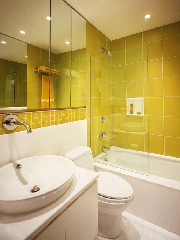 Yellow tiles--bigger ones in the shower/tub surround and smaller in ...
