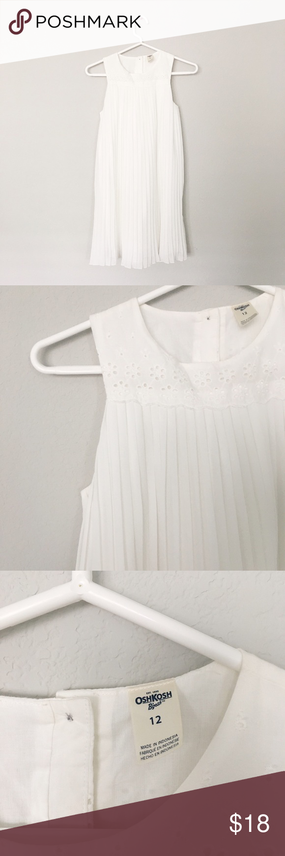 OshKosh White Swing Dress Title: Girls White Swing Dress   Condition: Pre-owned but in excellent condition  Color: White Type: Yoke: 100% Cotton. Skirt: 100% Polyester  Size: Girls 12  Brand: OshKosh Osh Kosh Dresses Casual