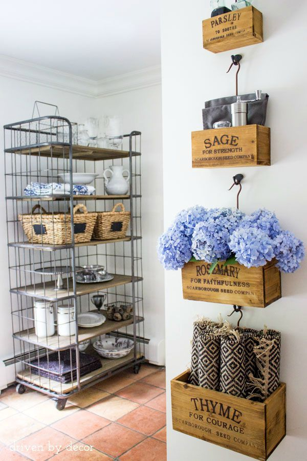 Kitchen: a baker's rack was added to an empty kitchen nook to maximize kitchen storage and display favorite serving pieces
