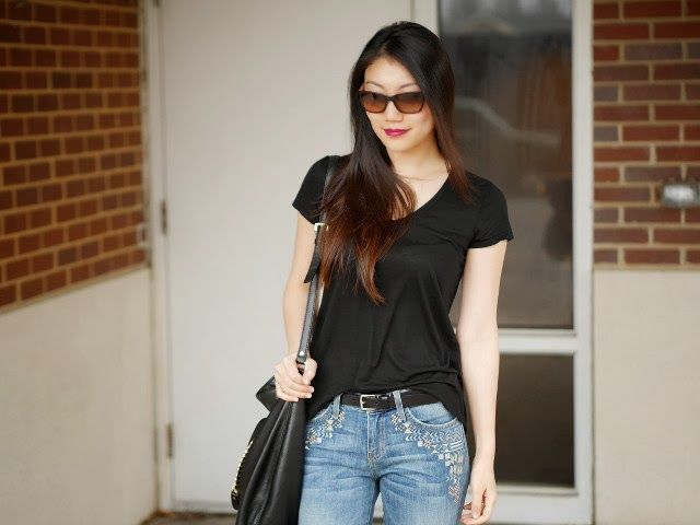 Black t-shirt and embroidered jeans