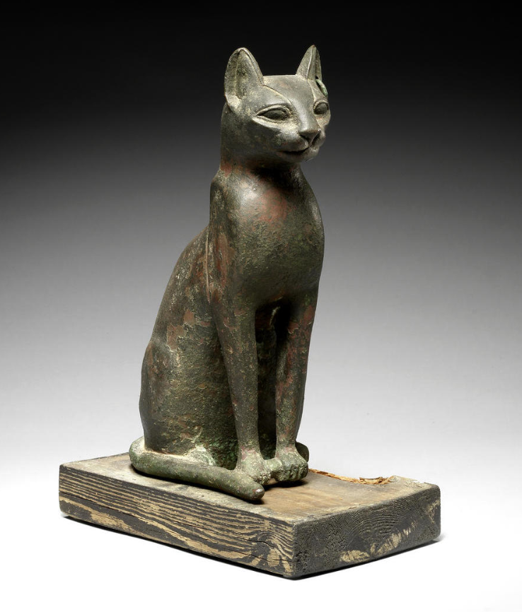 An Egyptian Bronze Cat Late Period, Circa 600 B.C. Hollow