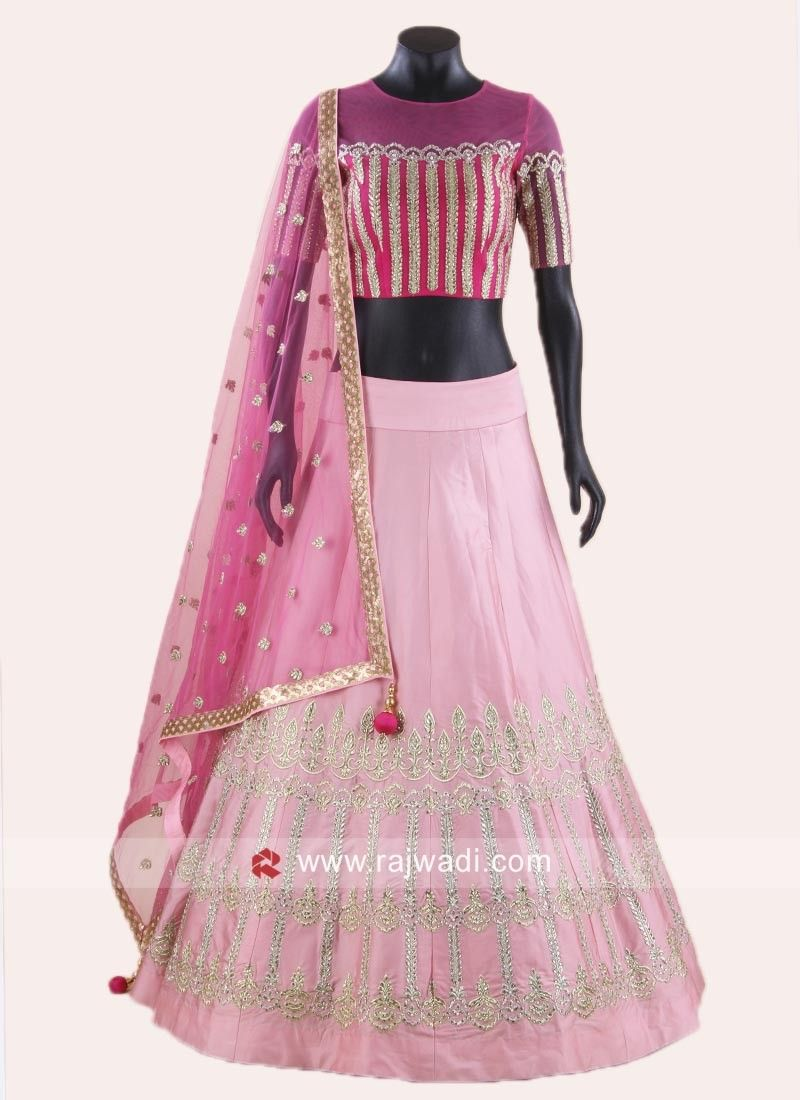 fd5856c6a8f9 Vibrant Light Pink Soft Silk Lehenga adorned with silver embroidery work  with Net embellished dupatta having golden lace border. A Net Choli  features zari ...