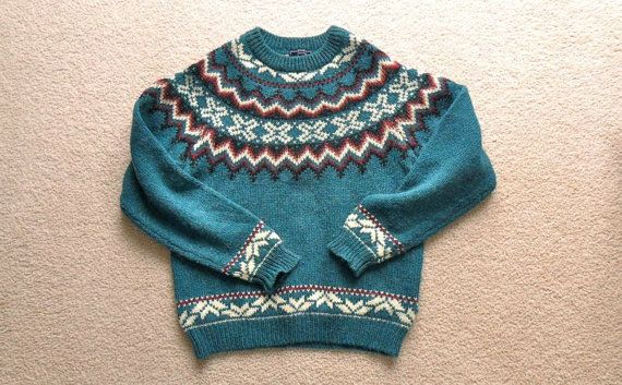 """This nordic sweater is labeled """"Woolrich Woman"""", made in Hong Kong."""