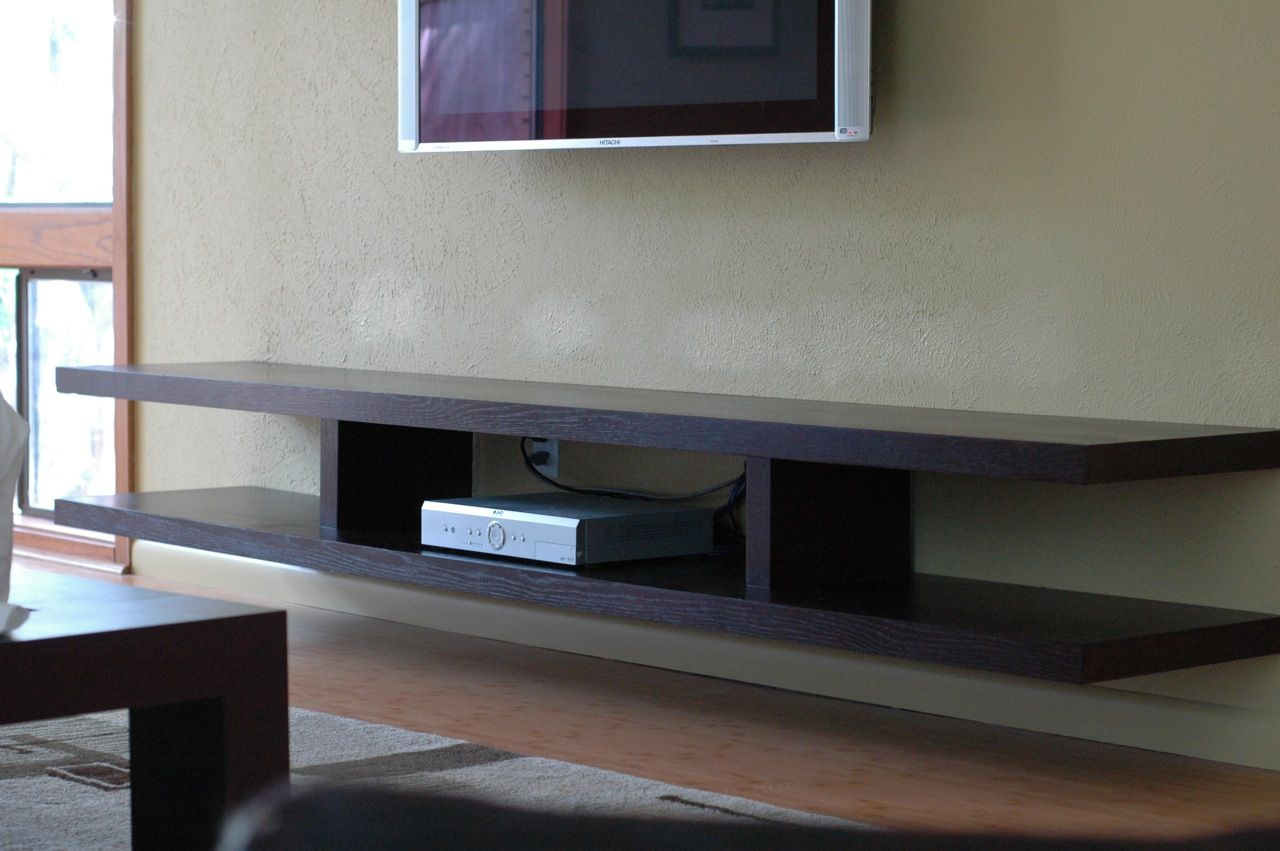 Wall Mouonted Tv Stand By Martin Askew Design With Laminated Finish On Cream  Wall Painted Plus White Led Television