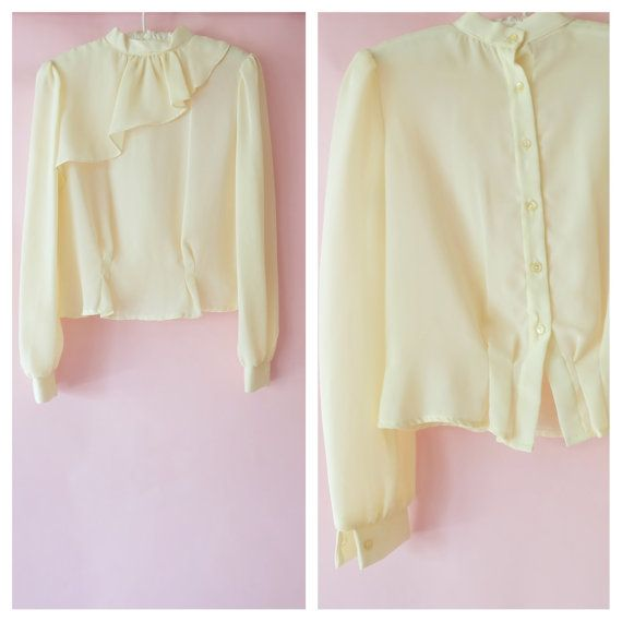 Check out this item in my Etsy shop https://www.etsy.com/listing/479344347/vintage-sheer-cream-cropped-fitted-boxy