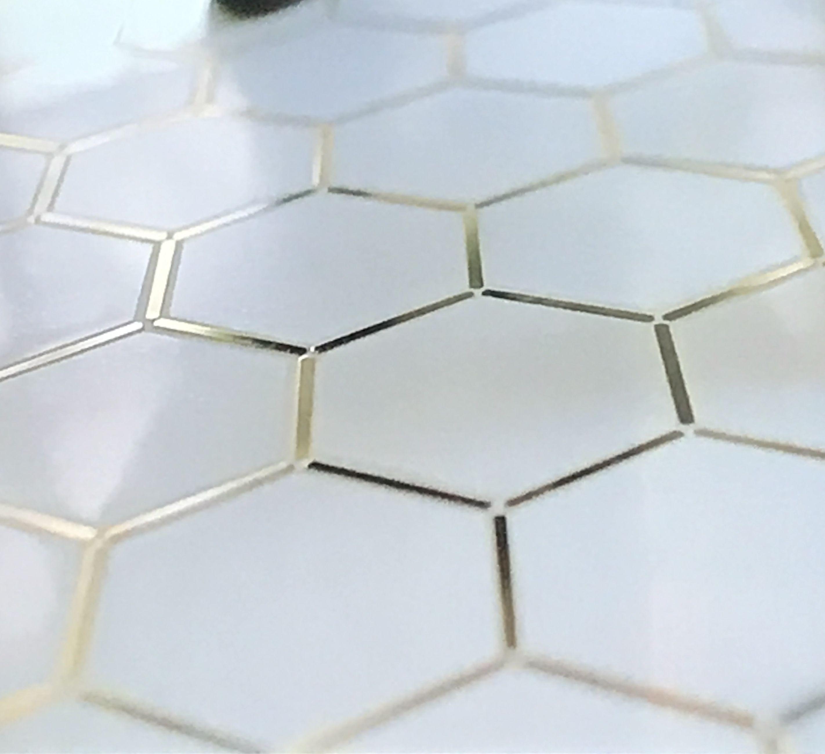 gold trimmed white hexagon tile white