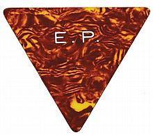 1977 Elvis Presley monogrammed guitar pick.  Estimate $400
