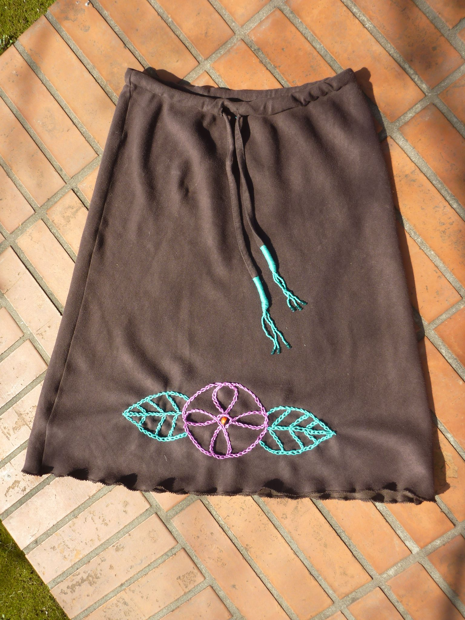 Brown cotton skirt with embroidered Ayahuasca flower and guairuro seed for protection.  www.facebook.com/MotherofWater