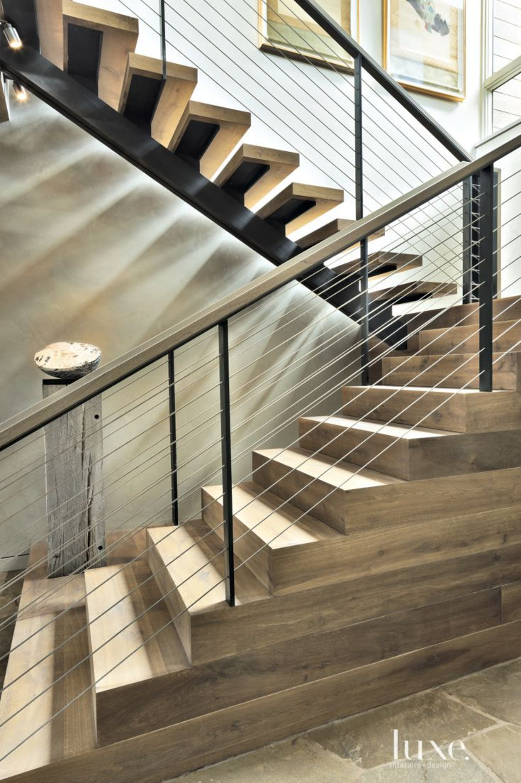 The entry staircase features white oak treads and risers to match the  flooring.