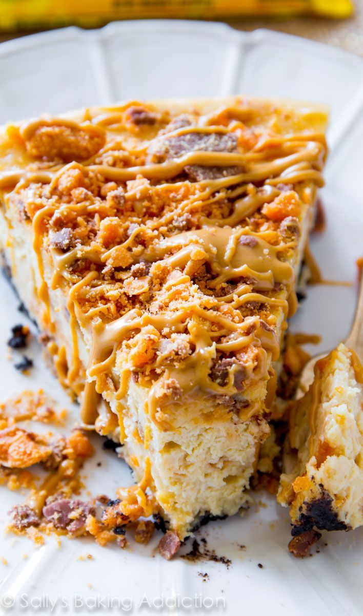 My friends went wild over this cheesecake recipe. Creamy, rich peanut butter cheesecake filled with crushed Butterfinger candy bars and topped with peanut butter drizzle. This is one incredibly indulgent dessert!