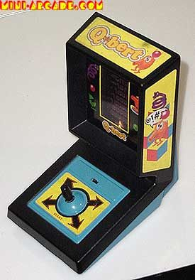 Q-Bert table top game.  This was my Faaaavorite!  So fun, wish I still had it.  Well I actually DIDN'T have it - my nephew Chris got it for Christmas one year but I literally took it away from it and played it more than he probably did!! :)