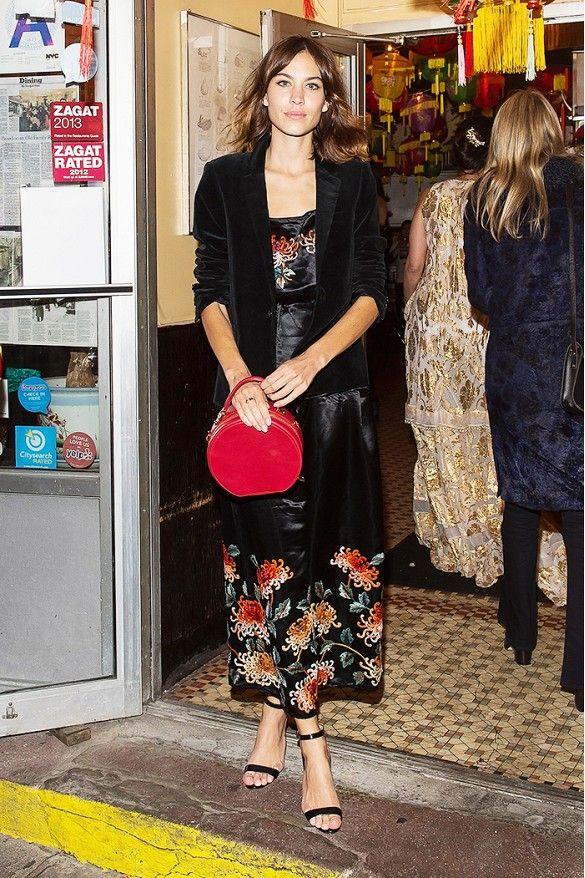 16bfa4e83b8102 Alexa Chung wears a silk floral dress with a velvet blazer, red handle bag,  and black sandals