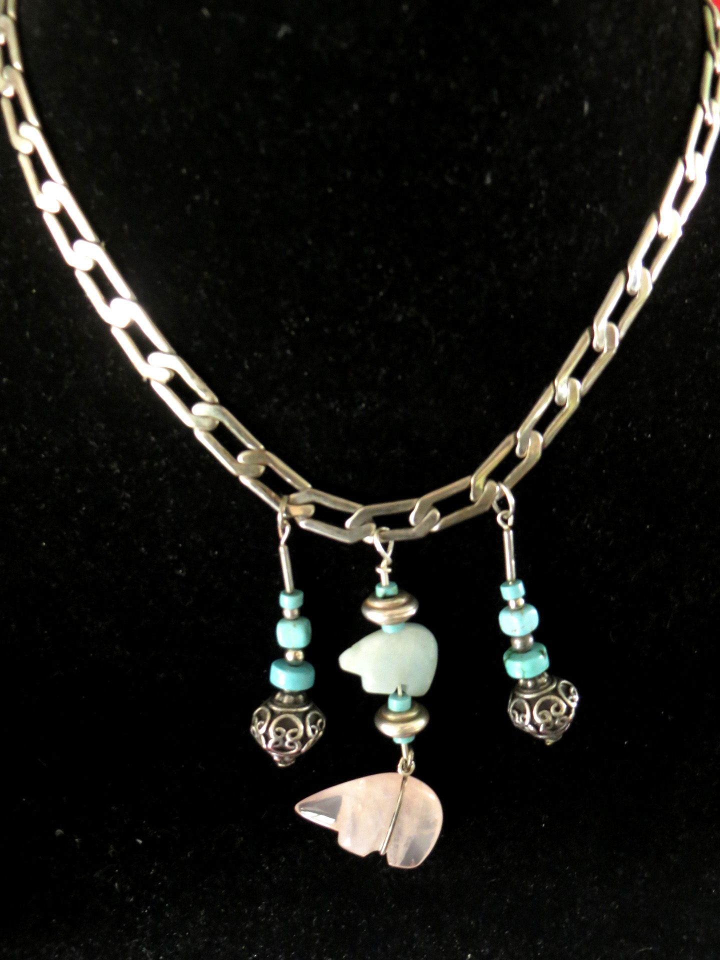Three multiple pendants define the magical look of this bold choker three multiple pendants define the magical look of this bold choker necklace the outer pendants combine turquoise and a hand made bead mozeypictures Gallery