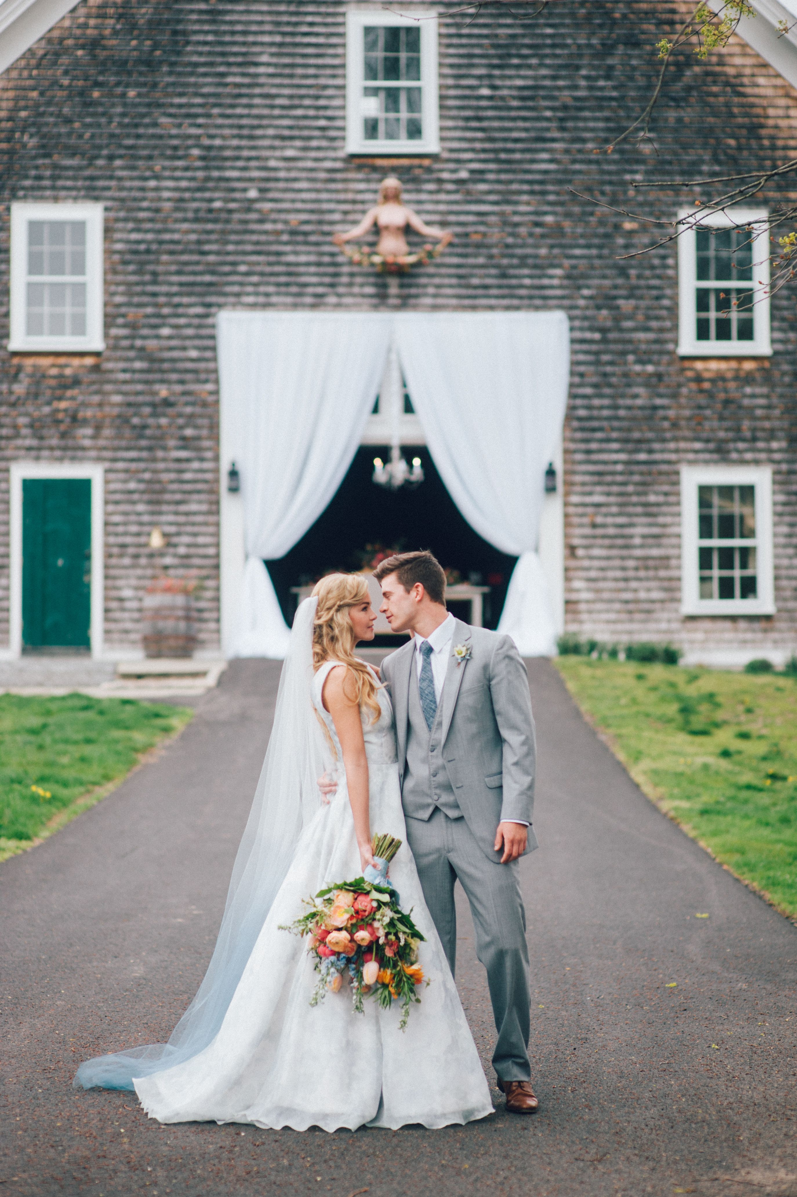 A painted blue floral wedding gown adds a touch of whimsy floral