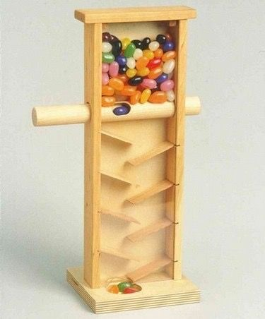 Jelly Bean DispenserSlinksn. (slingks) Surreptitious web links to other good sites For those with little self-restraint, the handcrafted wooden jelly bean candy machine dispenser is a godsend