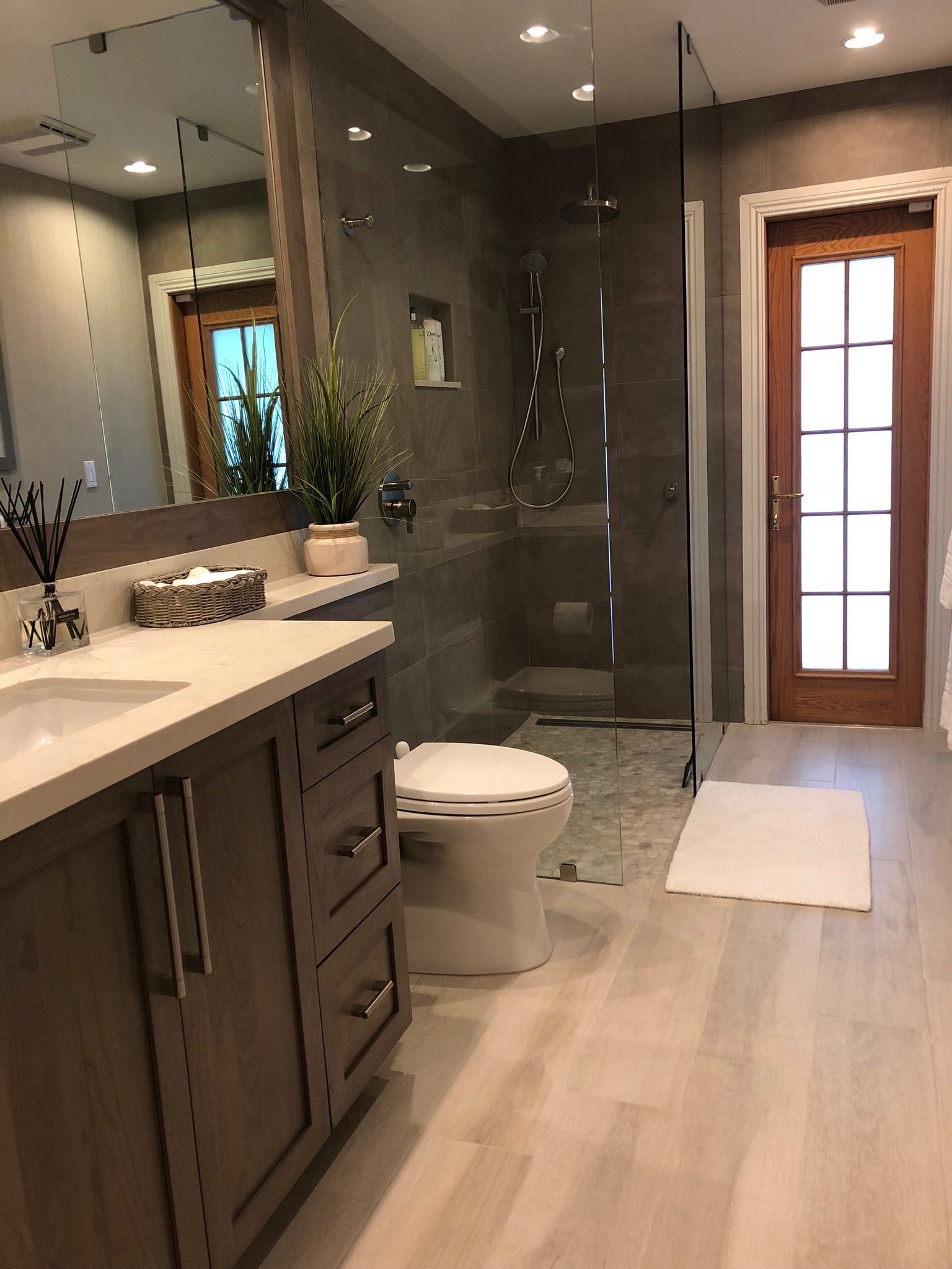 New cabana bath with walk in shower without doors. Wood