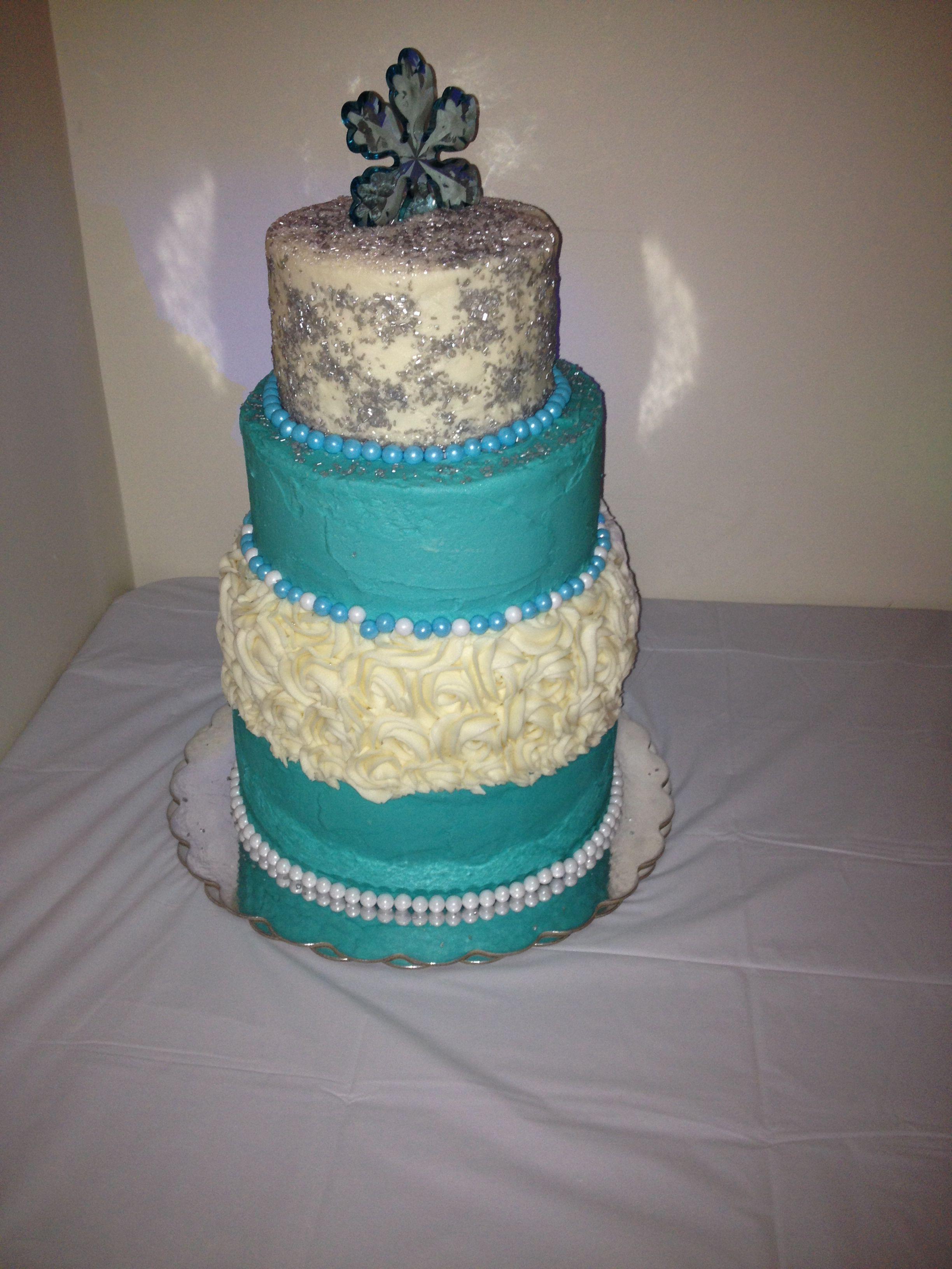 Winter wonderland teal sweet 16 four tiered birthday cake