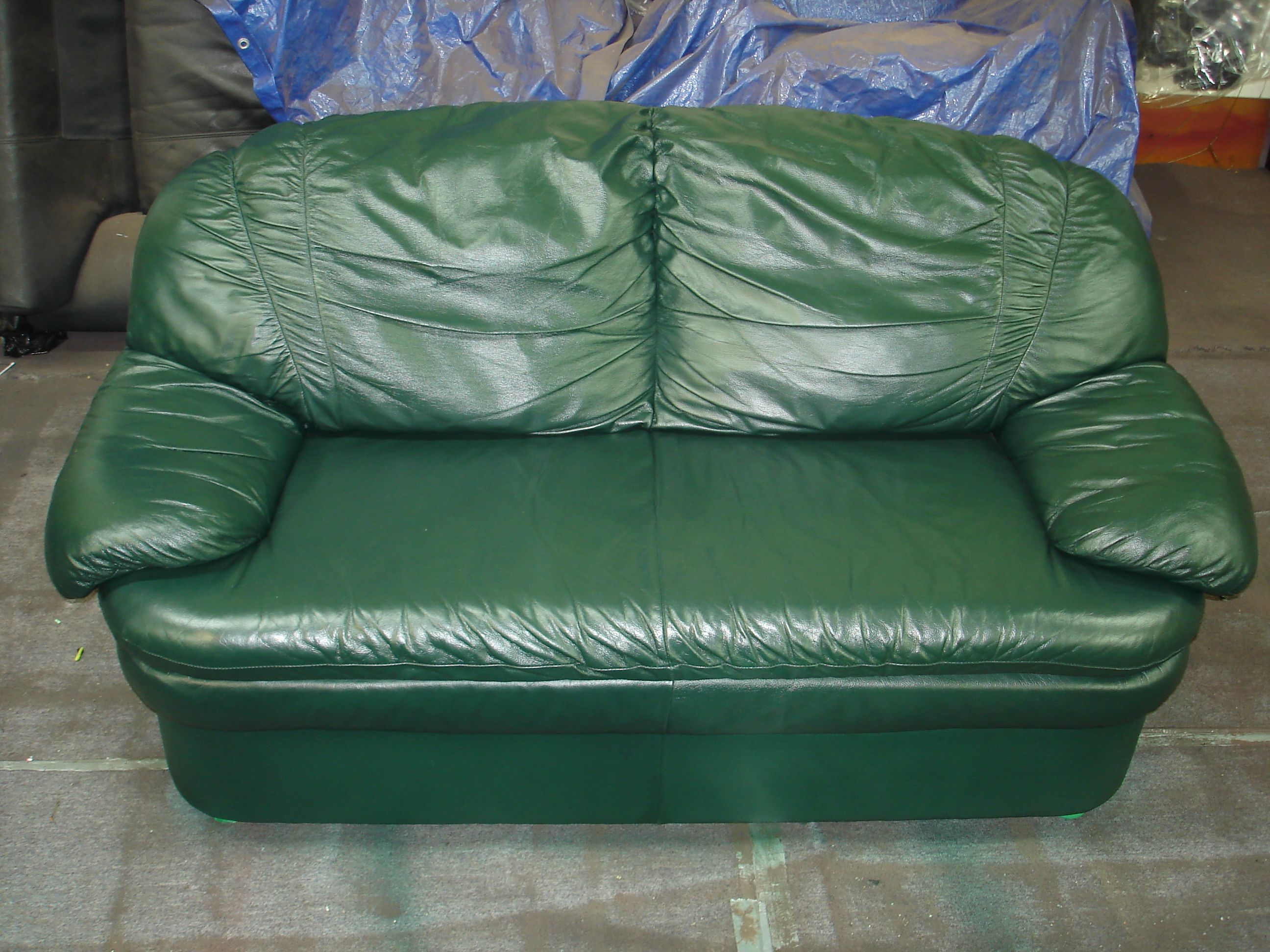 after picture of leather couch restored using leather repair filler and leather touch up dyes