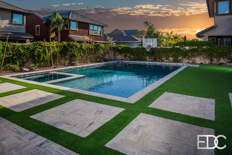 Pool spa combo with travertine deck, synthetic turf with pergola in Gilbert, AZ | Edgewater Design Company
