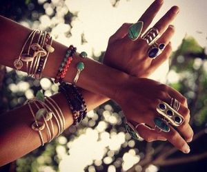 Stacked jewelry layered bangles modern hippie boho chic gypsy style. For the BEST Bohemian fashion trends FOLLOW http://www.pinterest.com/happygolicky/the-best-boho-chic-fashion-bohemian-jewelry-gypsy-/ now