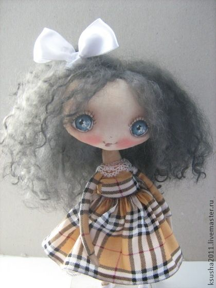 a SWEETHEART all dolled up in plaid....oh so SWEET!!!!...i LOVE her!...