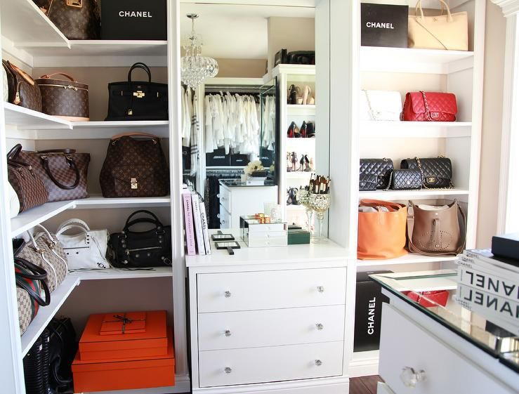 Gorgeous Designer Closet Features Beige Walls Lined With Wraparound White Bag Shelves Holding Louis Vuitton Bags Glam ClosetWalk