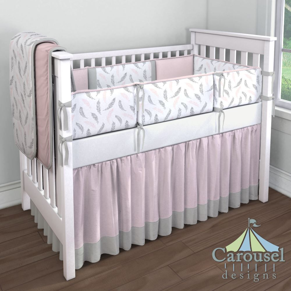 Feather Crib bedding in Solid Pink Minky, Blush Pink and Silver Gray Hand Drawn Feathers, Solid Silver Gray, Solid Antique White, Solid Pink. Created using the Nursery Designer® by Carousel Designs where you mix and match from hundreds of fabrics to create your own unique baby bedding. #carouseldesigns