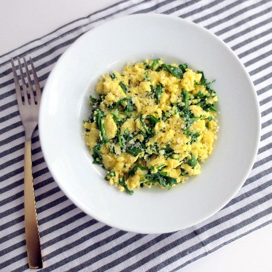 Scrambled eggs with wilted arugula, truffle oil and ...