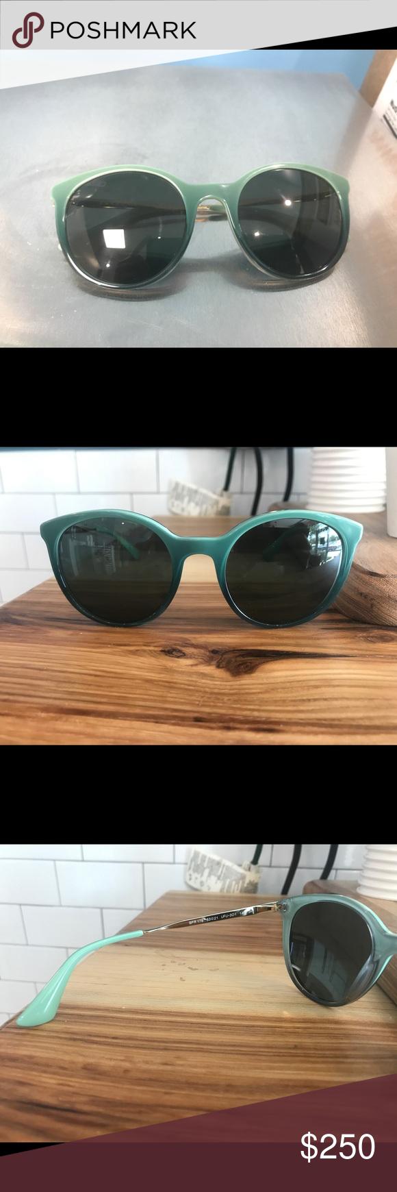fc1ff06027f Shop Women s Prada Blue Green size OS Sunglasses at a discounted price at  Poshmark. Description  Prada blue gold and green cinema sunglasses.