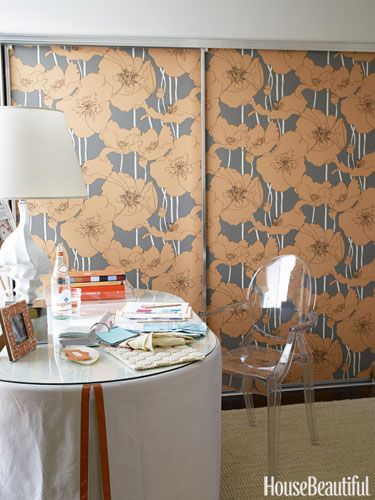 The fastest fix for dated sliding closet doors - wallpaper them!