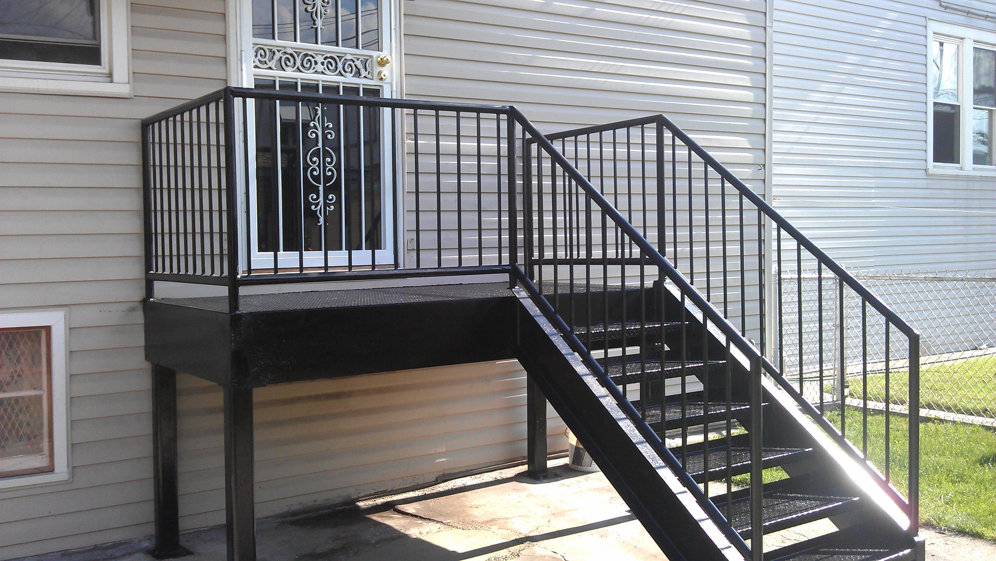 Metal decks steel deck stairs sandy derrick 39 s for Steel balcony