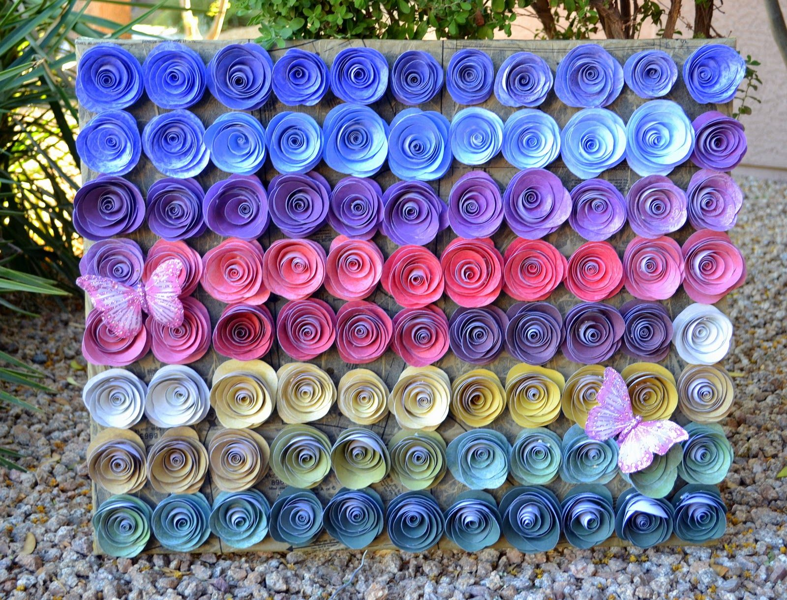 LESSology design team member Julie Tucker-Wolek decorated her canvas with 77 handmade paper blooms!