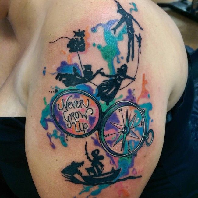8f8299700e54c Peter Pan and compass tattoo with a color splash. This is awesome ...