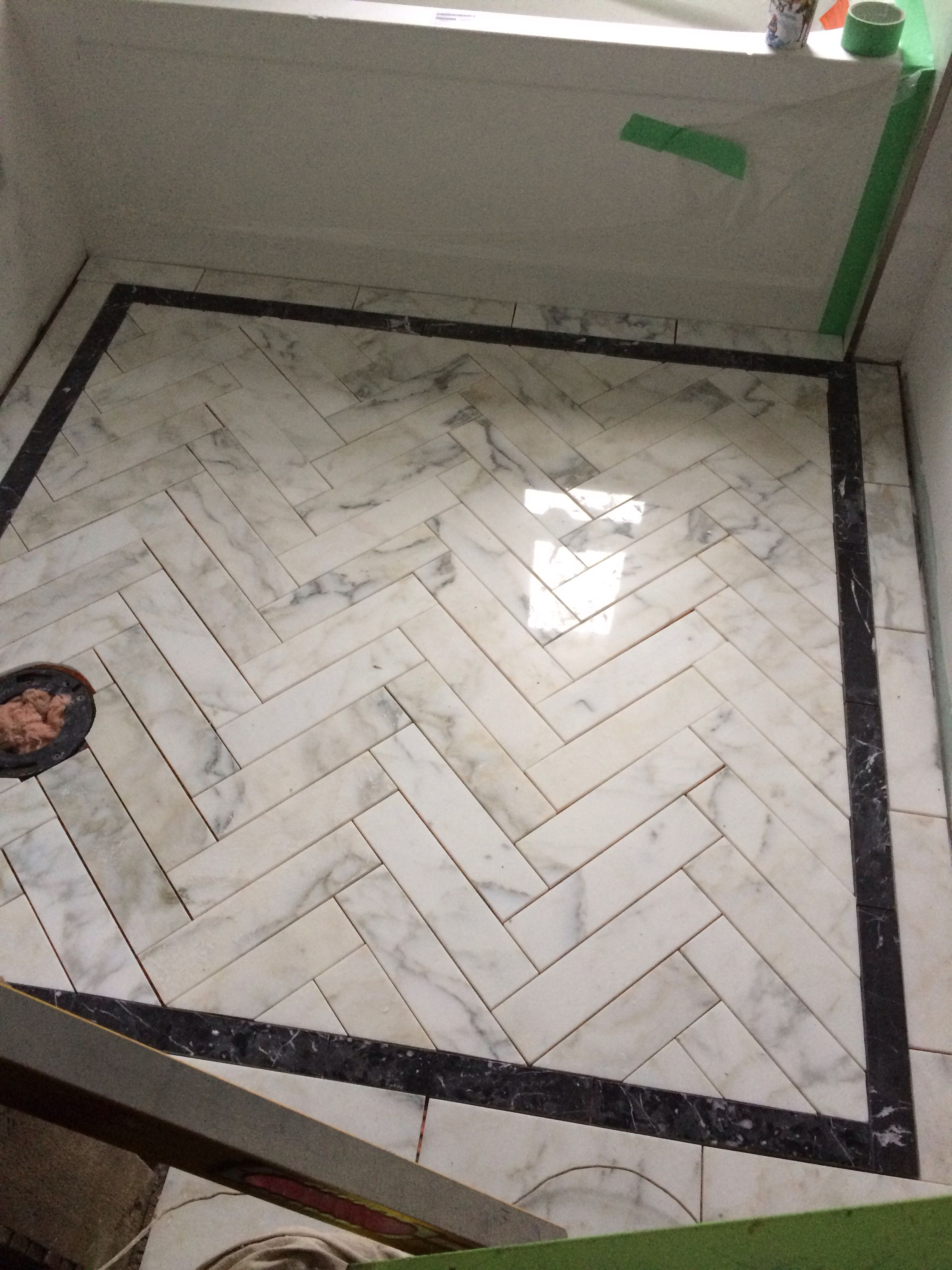Visual eye candy how to tile a herringbone floor part i - Dress Up Your Bathroom Shower Floor Add A Black Tile Accent Border To Gray Marble Herringbone