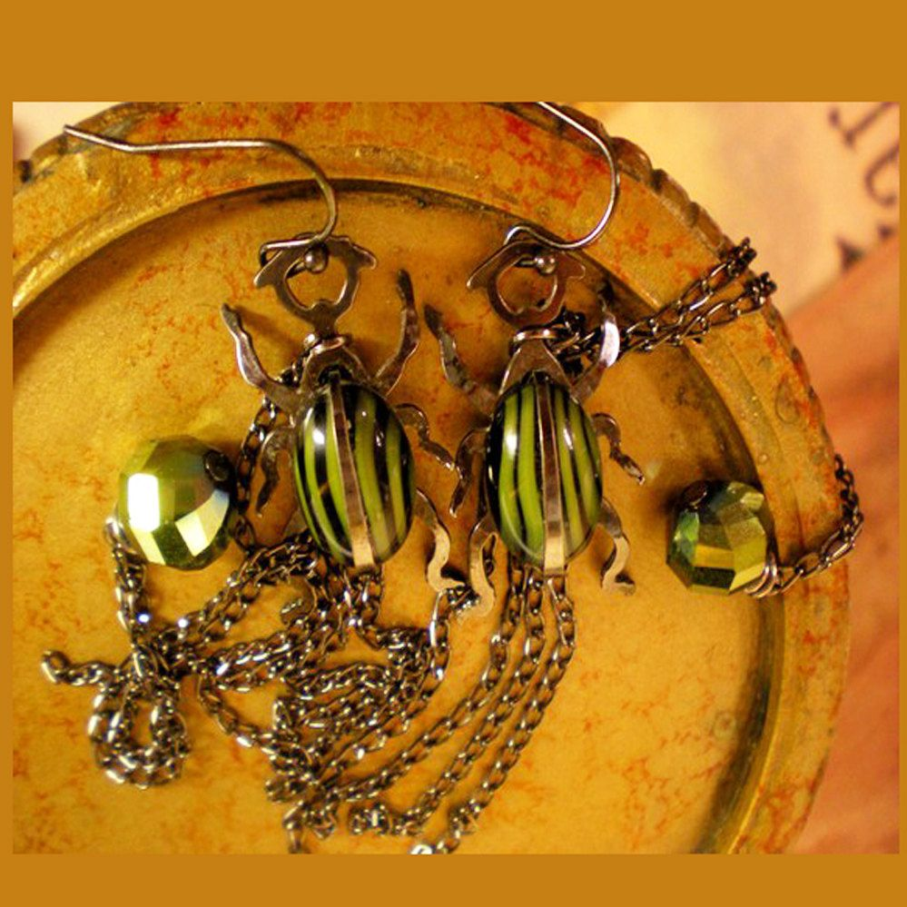 Green & Black Glass Scarab Beetle with Brass Metal Earrings  (Etsy, Florida, USA)