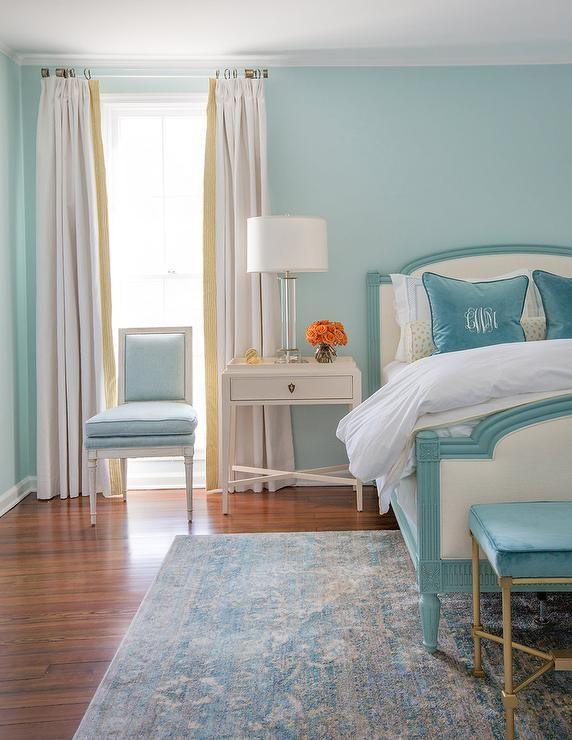 Restful Turquoise Blue Bedroom Is Furnished With A Turquoise Blue Framed  Ivory Upholstered Bed Dressed In White Hotel Bedding Topped With Blue Monou2026
