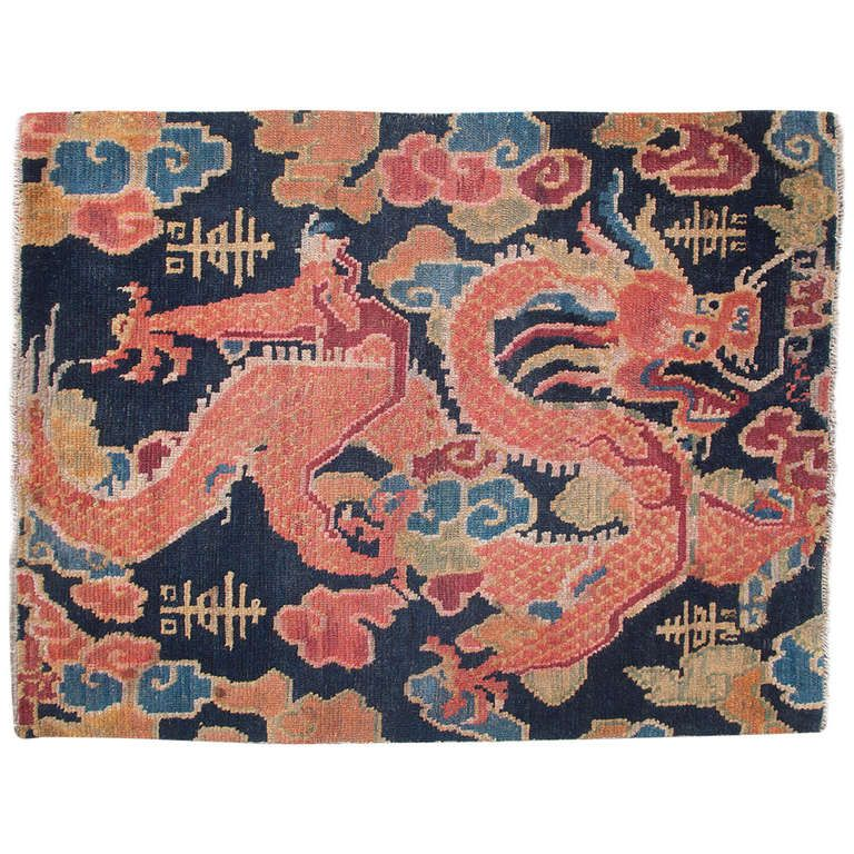 Charming Antique Tibetan Dragon Design Sitting Rug | From a unique collection of antique and modern chinese and east asian rugs at http://www.1stdibs.com/furniture/rugs-carpets/chinese-rugs/