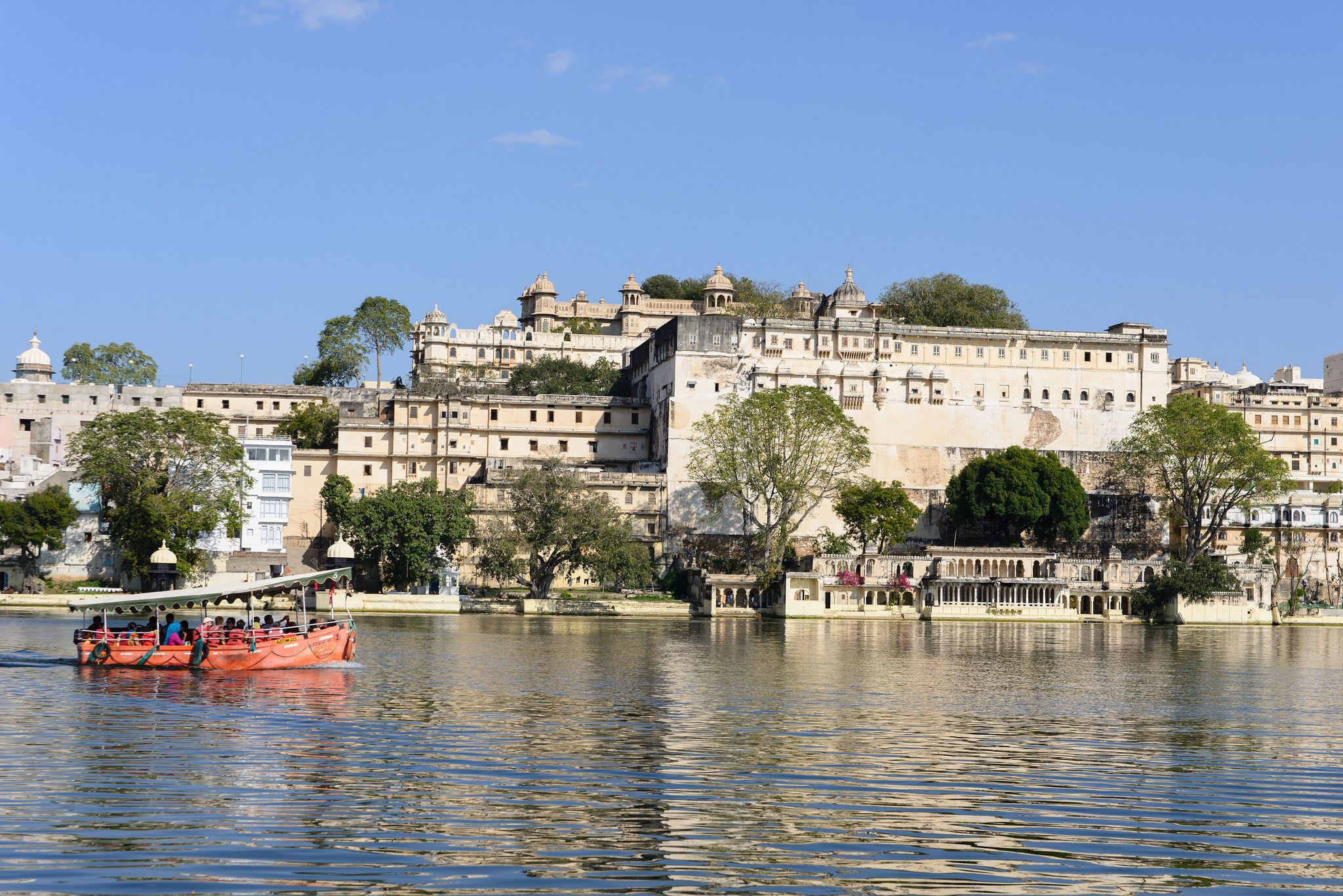 https://flic.kr/p/u2ATXa   Udaipur, India - Taj Lake Palace   Lake Palace is a luxury hotel, which has 83 rooms and suites featuring white marble walls. The Lake Palace is located on the island of Jag Niwas in Lake Pichola, Udaipur, India, and its natural foundation spans 4 acres. The hotel operates a speed boat which transports guests to the hotel from a jetty at the City Palace. It has been voted as the most romantic hotel in India and in the world.